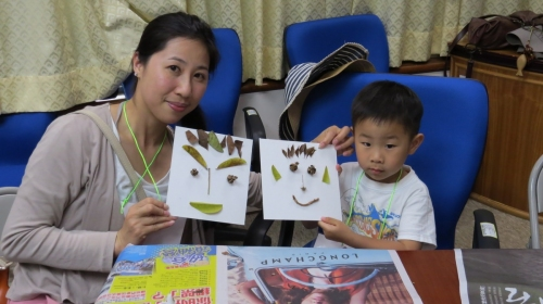 Parents and children doing it together to create art works with local plants materials